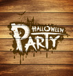 Halloween party on wood background