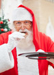 Santa Claus Eating Cookies Outdoors