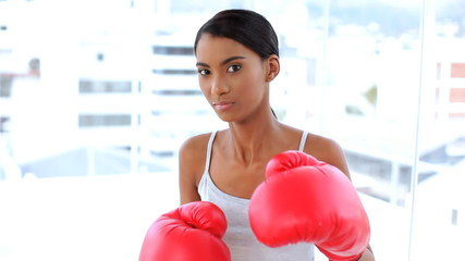 Woman fighting with boxing gloves