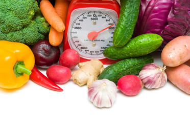 kitchen scale and vegetables close-up