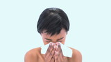 Attractive woman sneezing