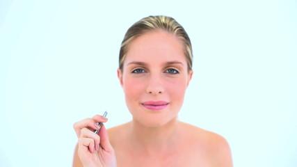 Beautiful woman plucking her eyebrow