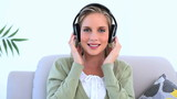 Woman wearing headphone and listening to music