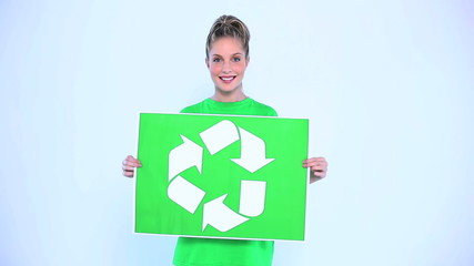 Blond woman holding a banner for the environment