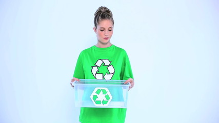 Blond woman giving a recycling box to the camera