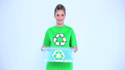 Blond woman holding a recycling box