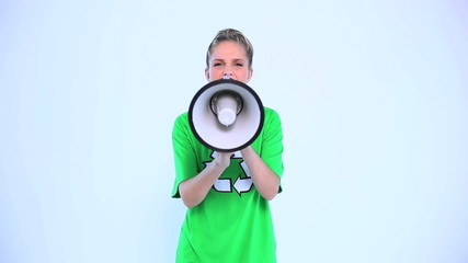 Attractive environmental activist screaming in a megaphone