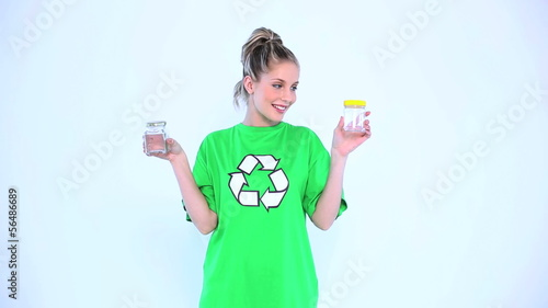 Attractive environmental activist holding two bottles