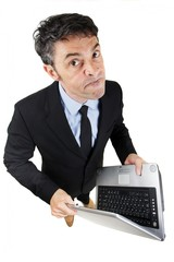 Pugnacious businessman holding a laptop