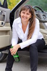 Happy woman drunkard in a car