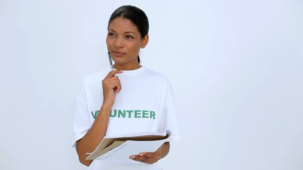 Volunteer woman thinking and writting on notebook