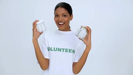 Volunteer woman showing two jar