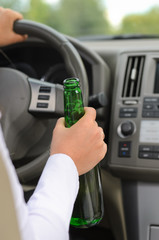 Woman drinking alcohol and driving