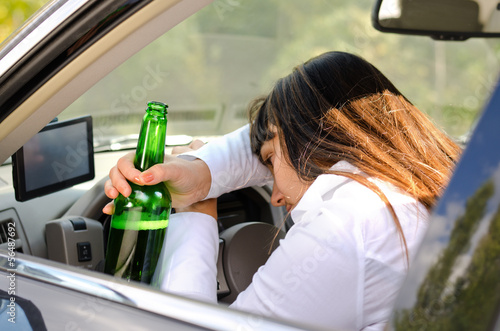 Drunk woman driver passed out in the car
