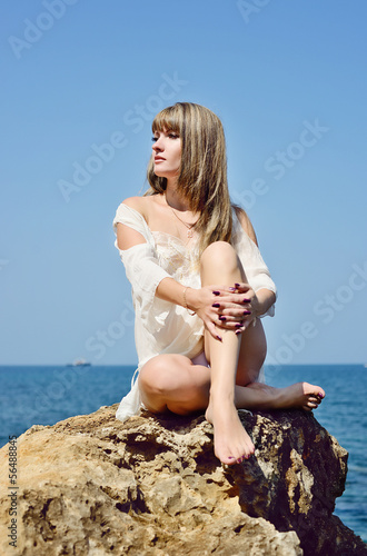 woman sitting near sea
