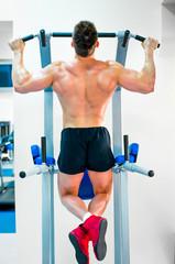 bodybuilder doing exercises
