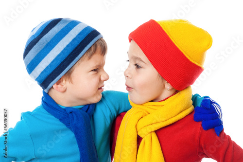Two speaking kids in winter clothes