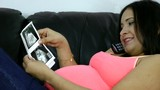 Pregnant in the phone with her baby's ultrasound scan