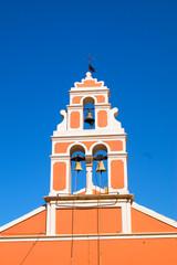 Church bell hanging from arch of bell tower, Fiskardo Kefallonia