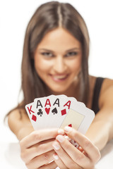 Happy girl holding the winning combination of poker cards