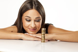 happy beautiful girl looking at her coins aligned in a column