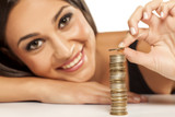 happy attractive girl arrange the coins in column