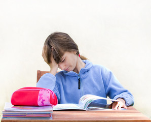 girl is bored with homework