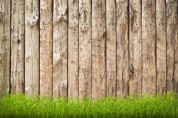 sfondo in legno con profilo d'erba