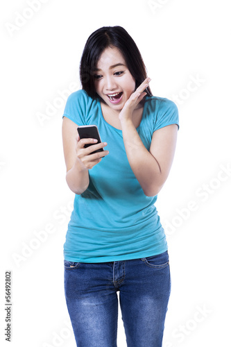 Surprised woman reading a text message