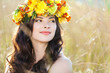Closeup portrait of beautiful young woman with flower wreath
