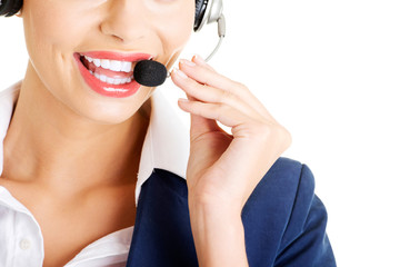 Pretty call-centre assistant smiling at the camera