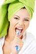 Happy teen girl singing to tooth brush