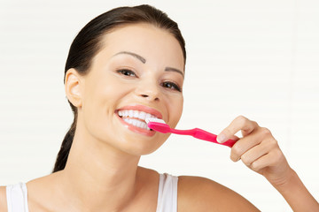 Woman holding tooth brush, isolated
