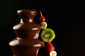 Fruits in chocolate fountain