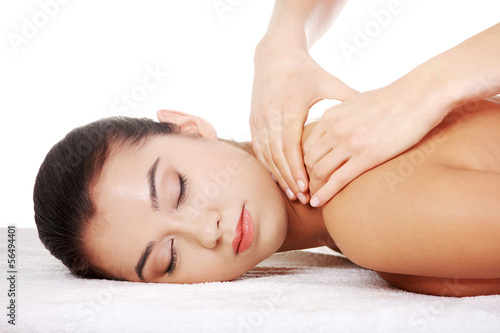Preaty young woman relaxing in spa saloon