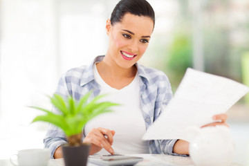 young woman paying bills