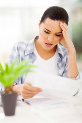confused young woman doing home financial
