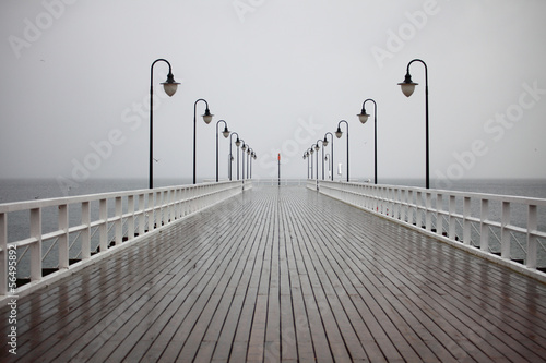old pier in rain on Baltic sea Orlowo Gdynia Poland - 56495892