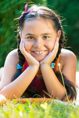 Portrait of pretty hispanic girl in summer day