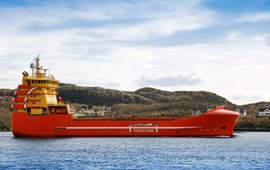 Red and yellow Norwegian platform supply ship