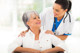 caring doctor with senior patient
