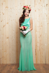 Smiling woman in mint dress with flower crown