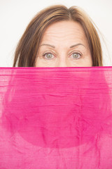 Woman behind cloth confident view