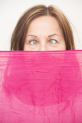 Woman behind cloth with squint look