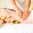 Woman having massage of body in spa salon
