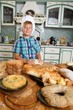 Young cook boy making homemade pastry