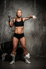 Beautiful muscular bodybuilder woman