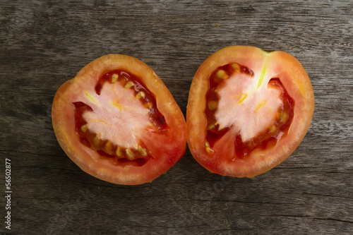 Slided Tomato on the wooden texture.