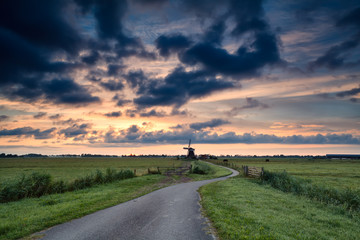 bike path to windmill at sunrise, Holland