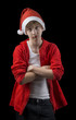 disappointed teen in Santa hat isolated on black background